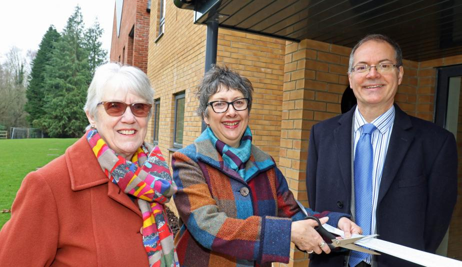 Cllr Gail Harris cuts the ribbon at Leander Court watched by Norwich Housing Society chairman Carol Sangster and chief executive Mike Allen web