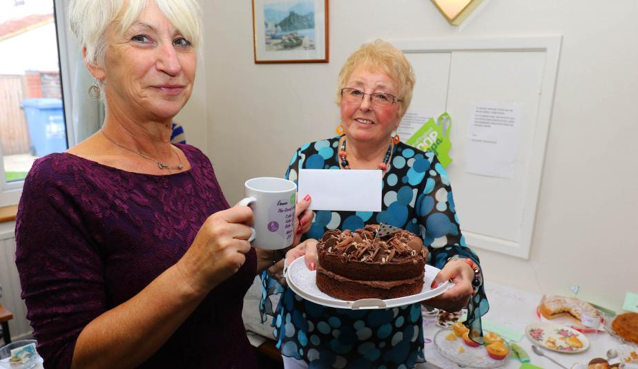 Norwich Housing Society scheme manager Sue Closs left with prizewinning baker Irene Young and her winning chocolate cake sm