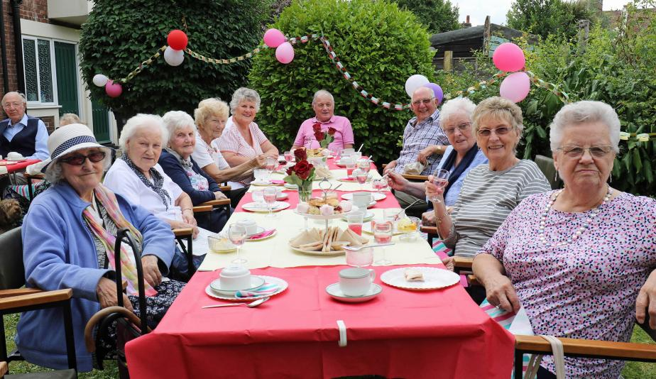 Residents of Norwich Housing Societys Eleanor Road complex enjoying their Strawberry Tea