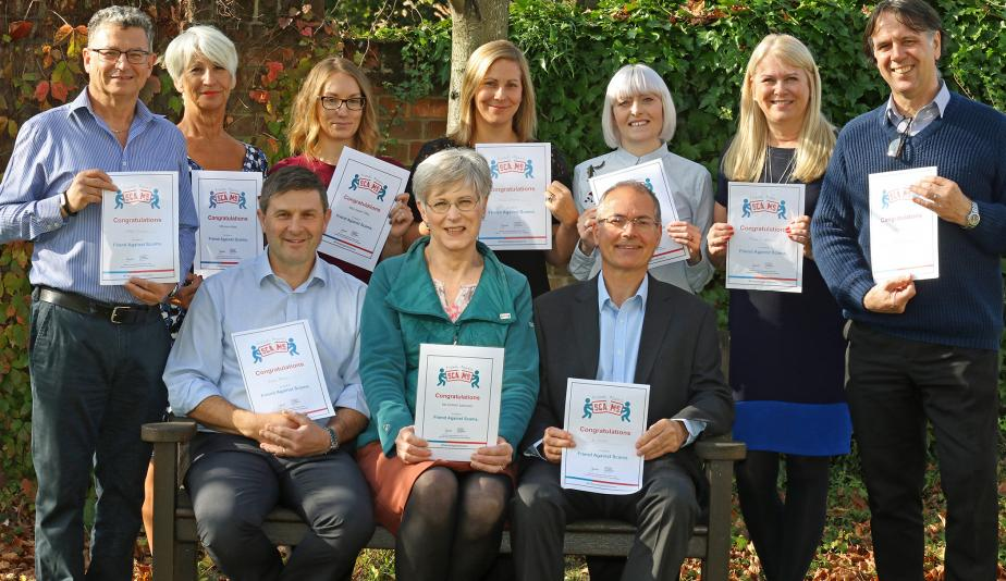 Staff at Norwich Housing Society with their Friends Against Scams certificates