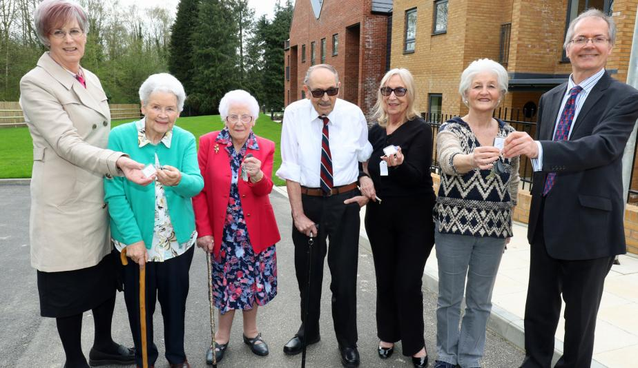 The first residents at Leander Court in Norwich receive their keys from Norwich Housing Society web