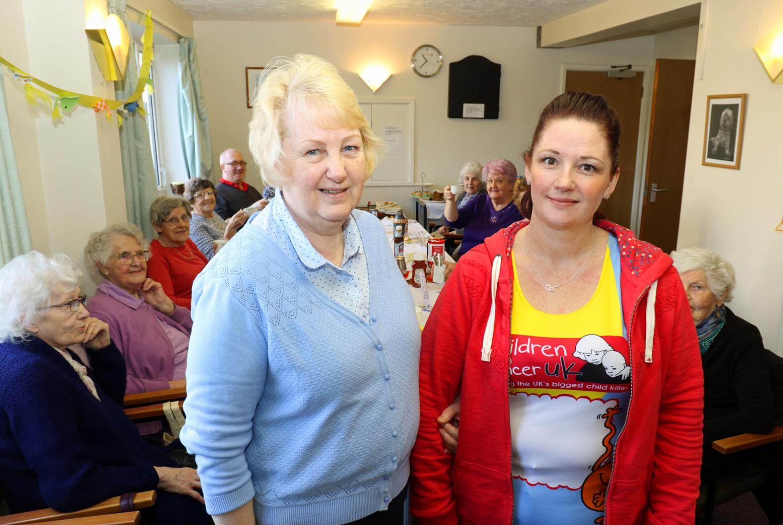 Marathon runner Marie Charles right with her mum Kathy Glanville at the fundraising coffee morning at Eleanor Road vsm2